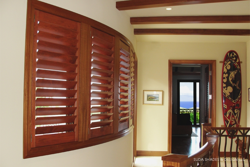 HERITANCE HARDWOOD SHUTTERS ON CURVED WALL